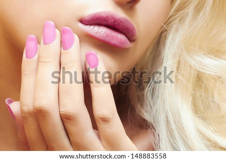lips,nails and hair of beautiful blond woman. close-up portrait. beauty girl - stock photo