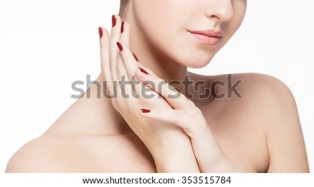 Lips Neck shoulders Hand manicure fingers Beautiful woman face close up portrait young studio on white