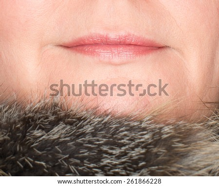 Lips of a beautiful woman with fur trim