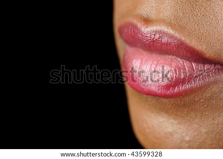 lips of a black woman with red lipstick