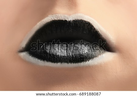 Lips of beautiful young woman with creative makeup, closeup