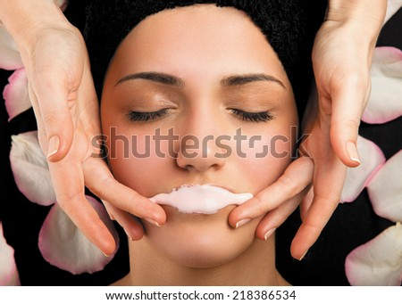 Lips therapy with a special gel in massage room. - stock photo