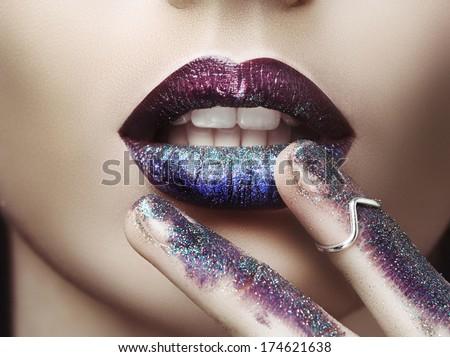 Lips with purple lipstick - stock photo