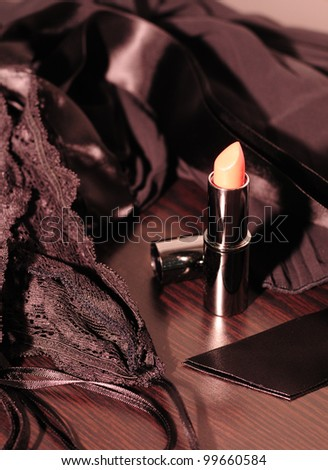 Lipstick and black lingerie for a romantic evening