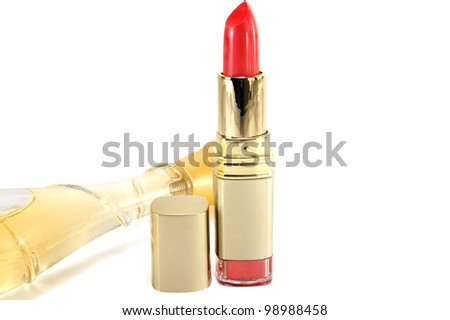 lipstick and bottle of perfume on a white background