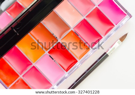 Lipstick and lip gloss makeup palette isolated on white background. - stock photo