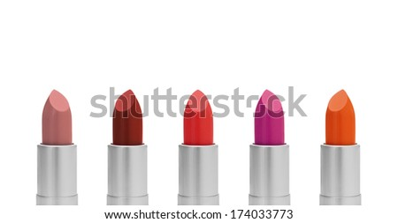 Lipstick of different colors, isolated on white background.