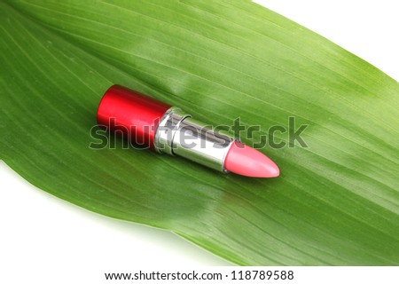 lipstick on green leaf isolated on white - stock photo
