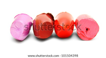 Lipstick slices. On a white background. - stock photo