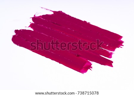 Lipstick smear and lipstick bar in pink color on white background,/ Lipstick.