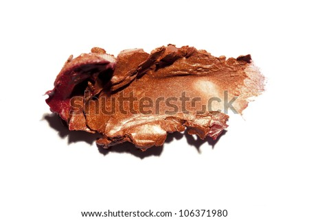 lipstick smeared on white background - stock photo