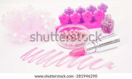 lipstick with pearls isolated on white background - stock photo