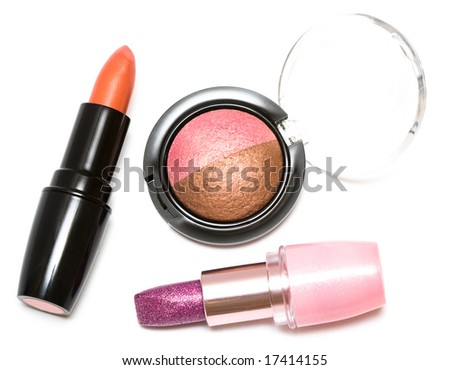 Lipsticks and eye-shadows isolated on white background - stock photo