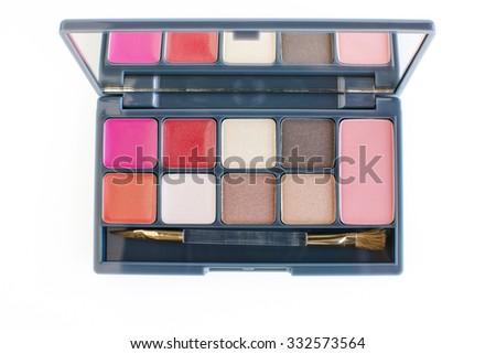 lipsticks,eye shadows and cheeks blusher makeup set on white background - stock photo