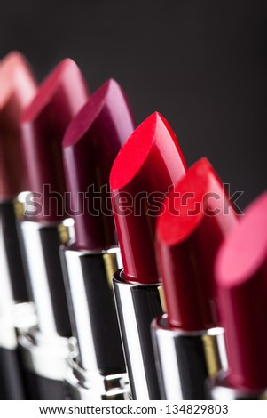 Lipsticks In A Row Isolated Over Gray Background