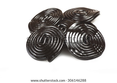Liqorice wheels candies close up on the white - stock photo