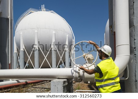 Liquefied Petroleum Gas tanks and Petrochemical Engineer. Engineers opens the gas valve