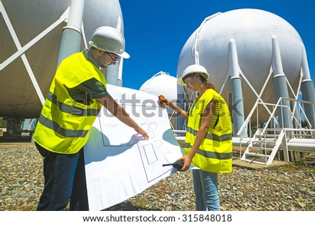 Liquefied Petroleum Gas tanks and Petrochemical Engineers - stock photo