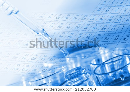 Liquid drop into test tube for testing in chemical laboratory. - stock photo