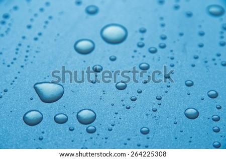 Liquid drops on a metal surface - stock photo