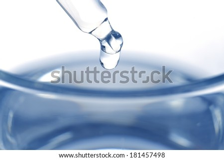 Liquid medicine in glass on white background