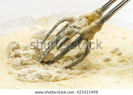 Liquid mix for pancakes and mixer - stock photo