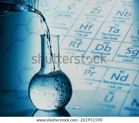 Liquid. Science concept,Pouring liquid into flask. - stock photo