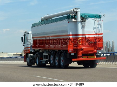 liquid tank truck driving on a highway