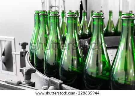 liquor bottles on the conveyor belt - stock photo