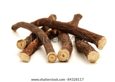 Liquorice roots on a white background - stock photo