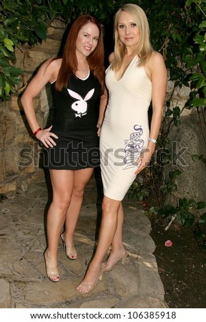 Lisa Cash and Alana Curry  at the 2nd Annual Game Day at the Playboy Mansion. Playboy Mansion, Holmbly Hills, CA. 02-01-09