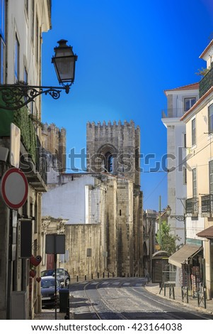 Lisbon city street with cathedral and railway, Portugal - stock photo