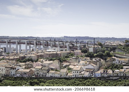 Lisbon Cityscape with bridge and houses, construction  - stock photo