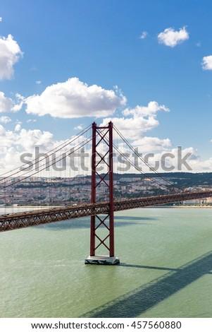 Lisbon cityscape with 25 de Abril suspension Bridge, Portugal - stock photo