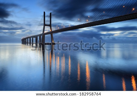 Lisbon is an amazing tourist destination because their urban landscapes, by its light, its monuments. The Vasco da Gama Bridge crosses the Tagus River, and is one of the longest bridges in the world. - stock photo