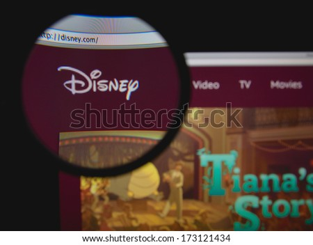 LISBON - JANUARY 26, 2014: Photo of Disney homepage on a monitor screen through a magnifying glass. - stock photo