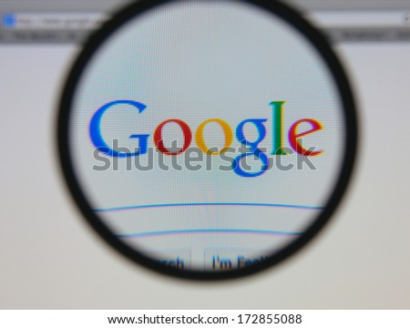 LISBON - JANUARY 23, 2014: Photo of Google homepage on a monitor screen through a magnifying glass. - stock photo