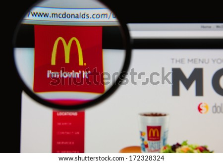 LISBON - JANUARY 20, 2014: Photo of McDonald's homepage on a monitor screen through a magnifying glass. - stock photo