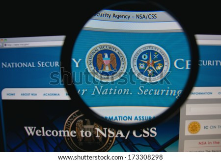 LISBON - JANUARY 27, 2014: Photo of the NSA/CSS homepage on a monitor screen through a magnifying glass. - stock photo