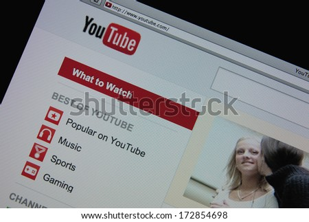 LISBON - JANUARY 23, 2014: Photo of Youtube homepage on a monitor screen. YouTube is a video-sharing website. - stock photo