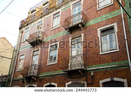 LISBON - JANUARY 10TH: The exterior of a traditional portuguese townhouse on January the 10th, 2015, in Lisbon, Portugal. Portugal is famous for their Azulejo tiling.