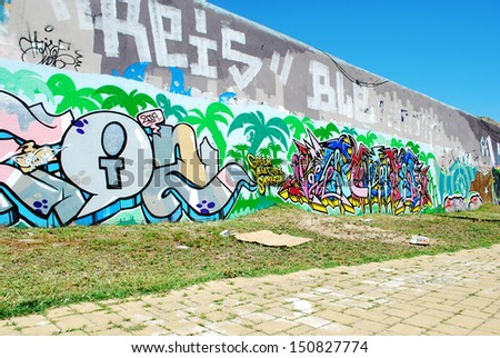 LISBON - MAY 25: street art by unidentified artist on authorized graffiti wall in Amoreiras quarter, Lisbon, Portugal on May 25, 2009 - stock photo