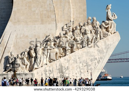 LISBON - November 10, 2015: Monument to the Discoveries - white stone ship shaped monument hailing Prince Henry and the Portuguese that Discovered the Roads of the Sea, Portugal - stock photo