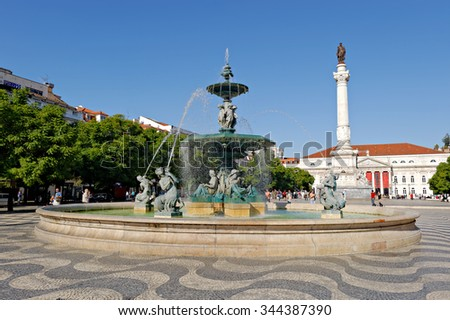 LISBON-NOVEMBER 08, 2015: The attractively paved square Rossio, Fountain, Column of Pedro IV (King Peter IV) and National Theater in Lisbon, Portugal on November 08, 2015 in Lisbon - stock photo