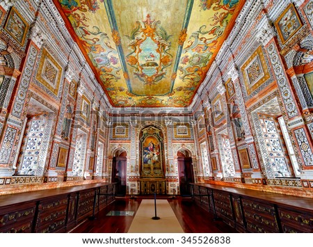 LISBON - NOVEMBER 11, 2015:The 18th century Sacristy at Monastery of Sao Vicente de Fora in Lisbon, Portugal, famous for its painted ceiling and exuberantly decorated walls with polychrome marble  - stock photo
