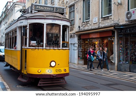 LISBON, PORTUGAL - APRIL 13: Actual and traditional yellow trams in Lisboa, Portugal. Is in operation since 1873 and now the traditional tram is a tourist attraction. On April 13 in Lisbon, Portugal