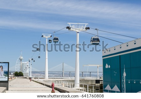 LISBON, PORTUGAL - APRIL 27: Cablecars by the river in Lisbon, Portugal on April 27, 2017