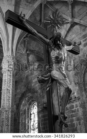LISBON, PORTUGAL - APRIL 22, 2015: Crucifix and ceiling inside the church of Jeronimos Monastery. This monastery is one of the most prominent examples of the Portuguese Gothic Manueline style.