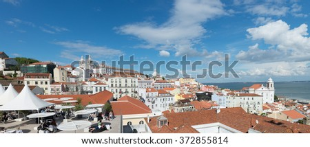LISBON, PORTUGAL April 21 ,2104: Panorama of Sao Vicente de Fora Monastery and the dome of the National Pantheon seen from Portas do Sol Belvedere in Alfama District. Lisbon, Portugal