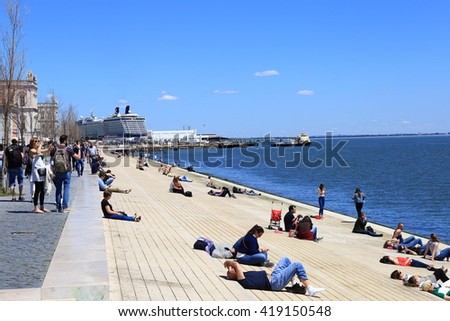 Lisbon, Portugal. April 25, people relax on the waterfront on a public holiday, April 25, 2016 in Lisbon Portugal. - stock photo